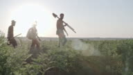 Silhouettes of Young Farmers Walking on Field video