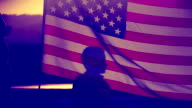 silhouettes with a US flag video