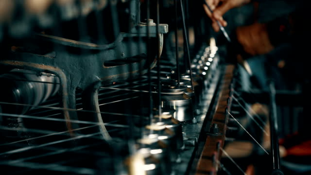 Silk spinning machine in a factory - Closeup video