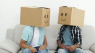 Silly employees with boxes on their heads giving thumbs up video