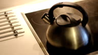 Silver Kettle is boiling on the electric hotplate. video