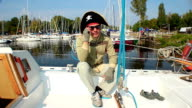 Simple guy wearing tricorn pirate hat, yachting, adventures video