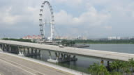 singapore sunny day famous flyer traffic street marina bay sands hotel panorama video
