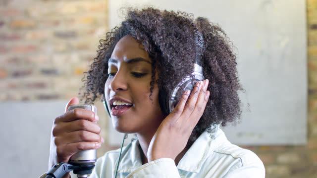 Singer in a recording studio video