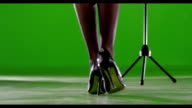 Singer legs. Female artist with microphone stand. video
