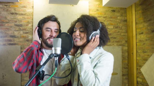 Singers singing at a recording studio video