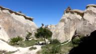 single woman is walking in Zelve National park in Cappadocia video