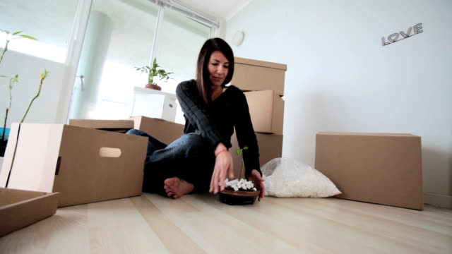 Single woman packing up her home video