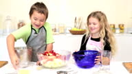 Sister and Brother baking together video