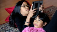 Sisters Have An Argument Using Digital Tablet video