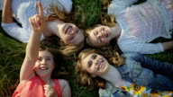 Sisters Lay In Grass, Youngest Points At Sky, They All Look Up Excitedly video