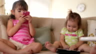 Sisters Playing on Smartphone and Tablet Computer video