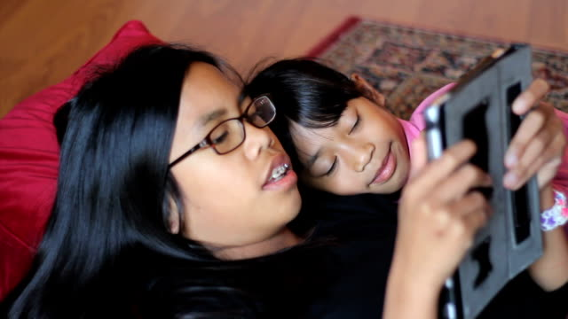 Sisters Spend Time Together On New Digital Tablet video