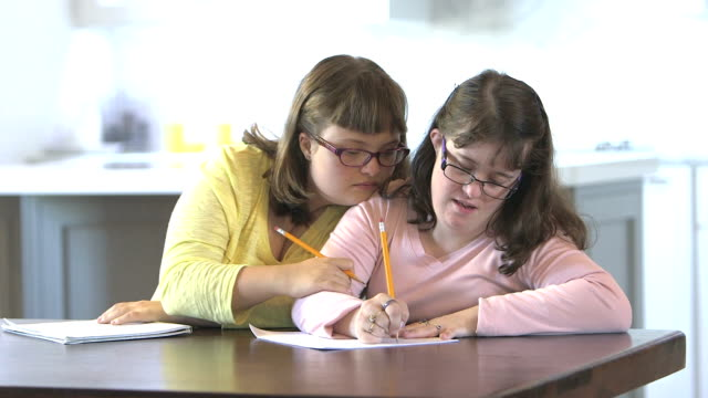 Sisters with down syndrome doing homework video