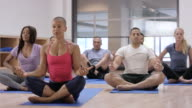 Sitting Down to Meditate in an Indoor Fitness Class video