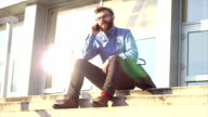 sitting on the stairs and talking on the phone video