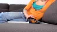 sitting woman reading magazine video