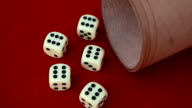 six dice with cup on red rotating table video
