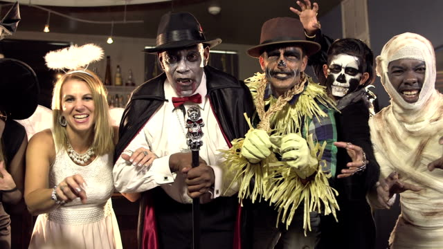Six multi-ethnic adults at costume party video
