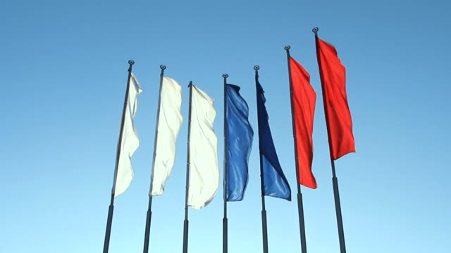Six red, blue and white flags fluttering on the wind video