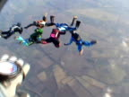 Six skydivers doing formation video