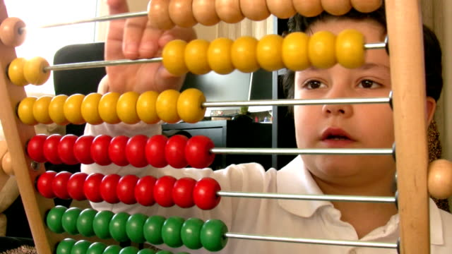 Six  years old boy with abacus video