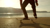 SLOW MOTION: Skateboarder doing jumping tricks spinning skateboard in the air video