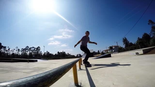 Skateboarder grinding down rail video