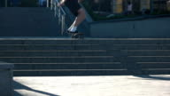 Skateboarder jumping in slow-mo. video