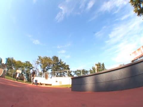skateboarder K grind ledge video
