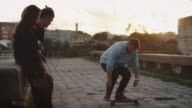 Skateboarder performing Tricks for his Teenager Friends. video