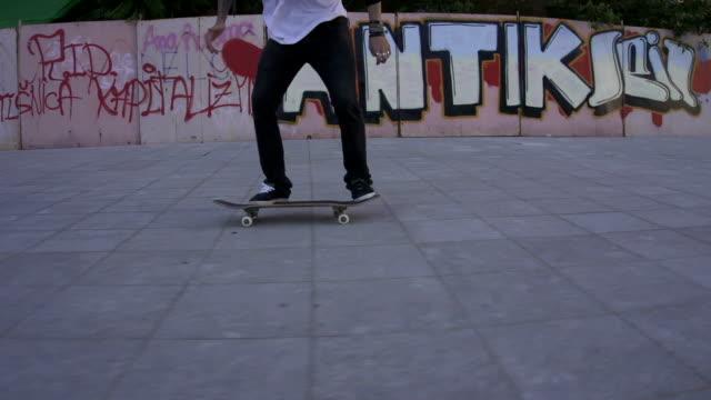 Skateboarder performing tricks video