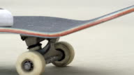 SLOW MOTION EXTREME CLOSE UP: Skateboarder skating on street, wheels spinning video