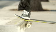 SLOW MOTION CLOSE UP: Skater grinding with skate performing nose slide trick video