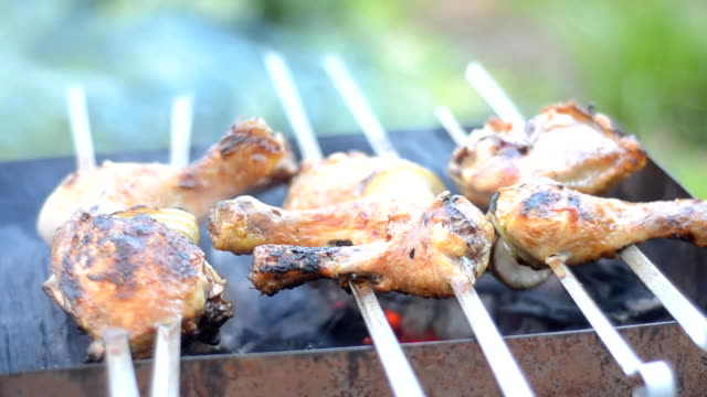 Skewers of chicken, grilled video