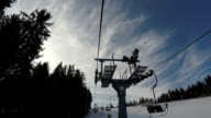 Ski lift moves up to the top of the mountain. video