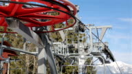 Ski lift wheel on the top of the mountain. video
