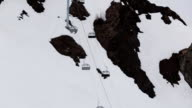 Ski resort. View of snowy mountains. Ski lifts. Grey weather. Nature. Landscape video