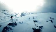 AERIAL Ski tourer on mountain ridge video