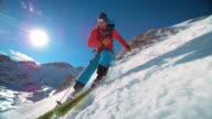 SLO MO TS Ski tourer skiing down the mountain video