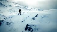 AERIAL Ski touring over the mountain ridge video