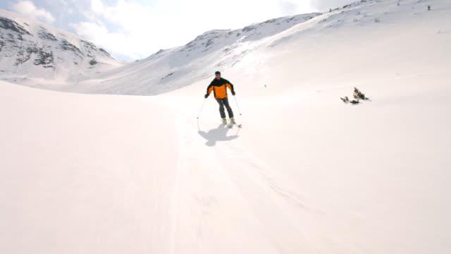 skier carving behind camera video