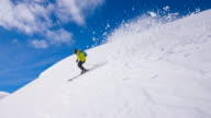 Skier going down the mountain, riding freshly fallen snow video