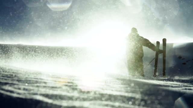 Skier Raising Hands Mountain Top Sun Flare video