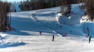 Skiers go down on ski resort slope video