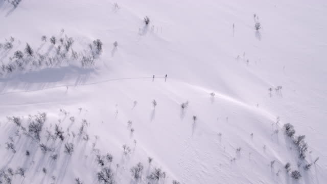 Skiers hiking through the snow video