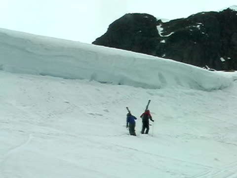 Skiers walking video