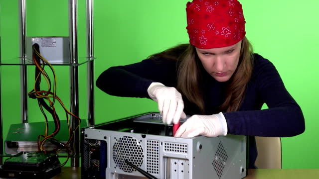 Skilled girl with headscarf repairing desktop pc. Computer repair service video