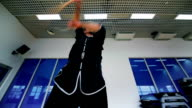 Skillful man training the wushu with wooden stick in the gym video