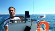 Skipper on sailing boat on Adriatic sea video